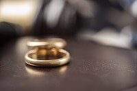 Wedding rings on a table in a contested divorce case
